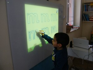 Tracing the metter M on the interactive whiteboard
